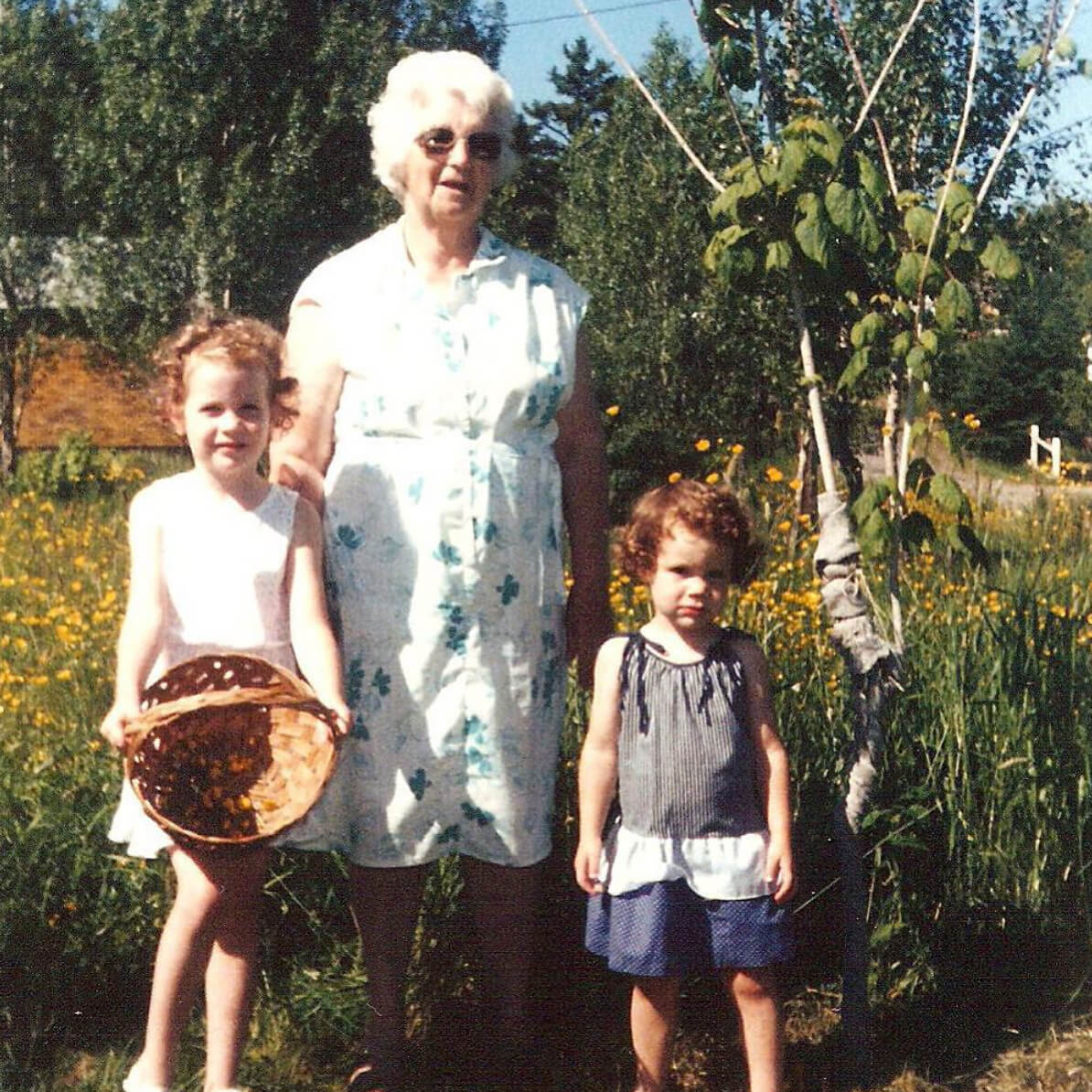 Grandma and two girls in a garden